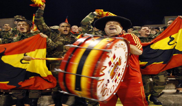 Spain fans bang the drum