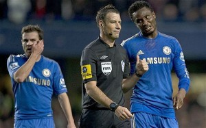 Referee Mark Clattenburg argues with Chelsea players