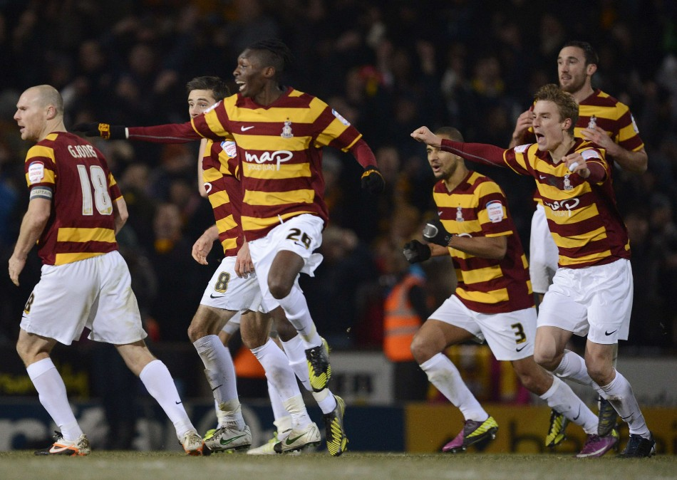 Bradford City players celebrate beating Aston Villa at Valley Parada