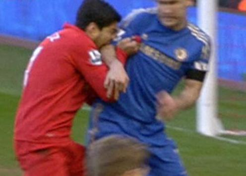 why did luis suarez bite another player?
