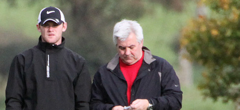 Rooney and agent Paul Stretford. Photo by PA