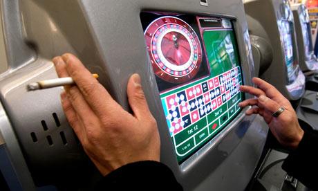 Gambler places a bet at a fixed odds terminal