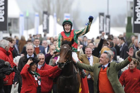 Tom Scudamore celebrates  victory aboard Moon Racer. A 9/1 winner for VG TIPS