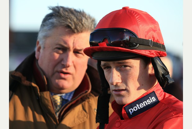 Jockey Sam Twiston-Davies with trainer Paul Nicholls before the The Betfred Goals Galore Challow Novices' Hurdle Race during Betfred Challow Hurdle Day at Newbury Racecourse, Berkshire. PRESS ASSOCIATION Photo. Picture date: Monday December 29, 2014. See PA Story RACING Newbury. Photo credit should read: Nick Potts/PA Wire.