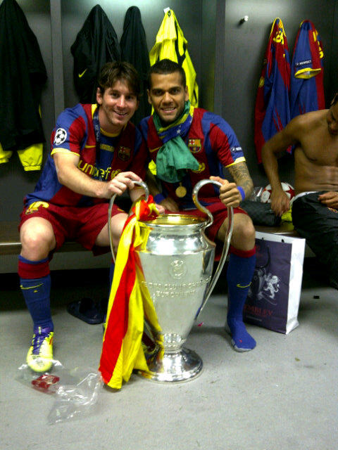 alves and messi lift europan cup