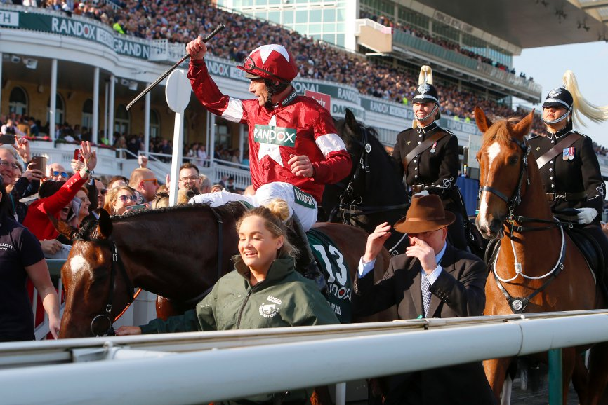 Tiger Roll on way to winners enclosure at aintree