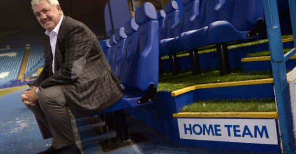 steve bruce sits in hillsborough dugout