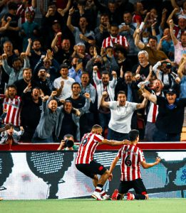 Brentford players and fans celebrate home win